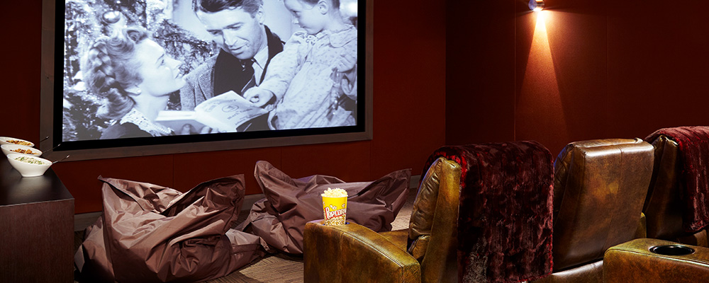 A private theater plays a film for members of an Aspen fractional ownership program.