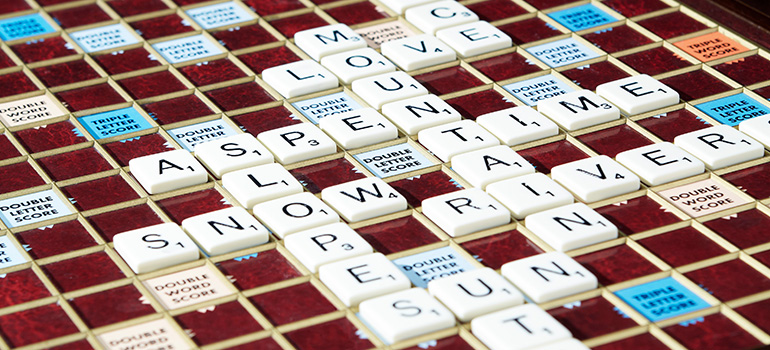 A game of scrabble sits ready for players to resume spelling Aspen-relevant words.
