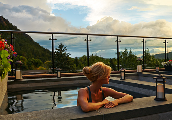 A member of the Aspen fractional ownership program soaks in a rooftop pool.