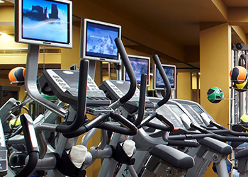 Exercise bikes stand ready for use in the spa.