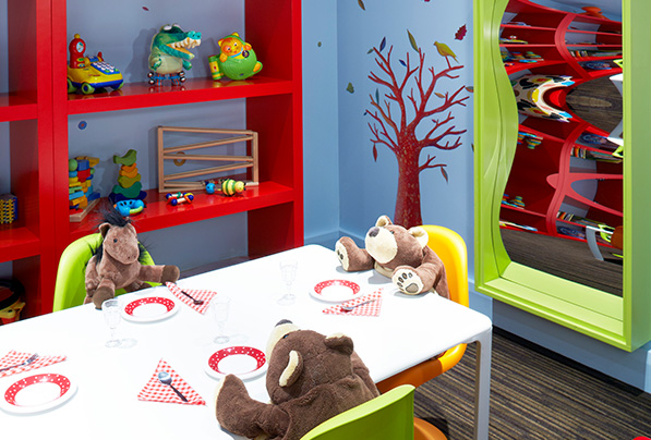 The children's room sits ready with toys and stuffed animals for kids to enjoy.