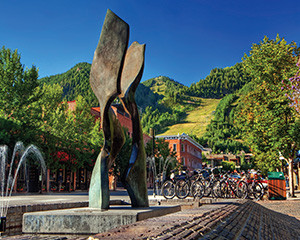 A modern sculpture in downtown Aspen stands under a clear blue sky.